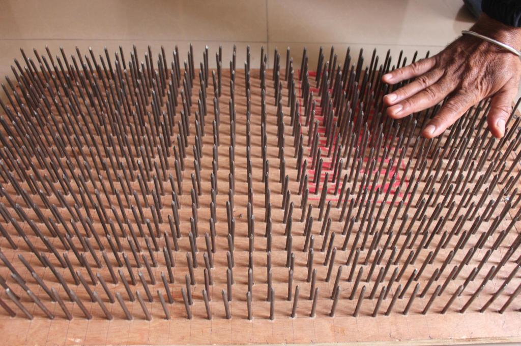 A bed of nails that Manoj can lie down on to demonstrate how to bear pain - one of his stunts. Photo by Sonia Paul.