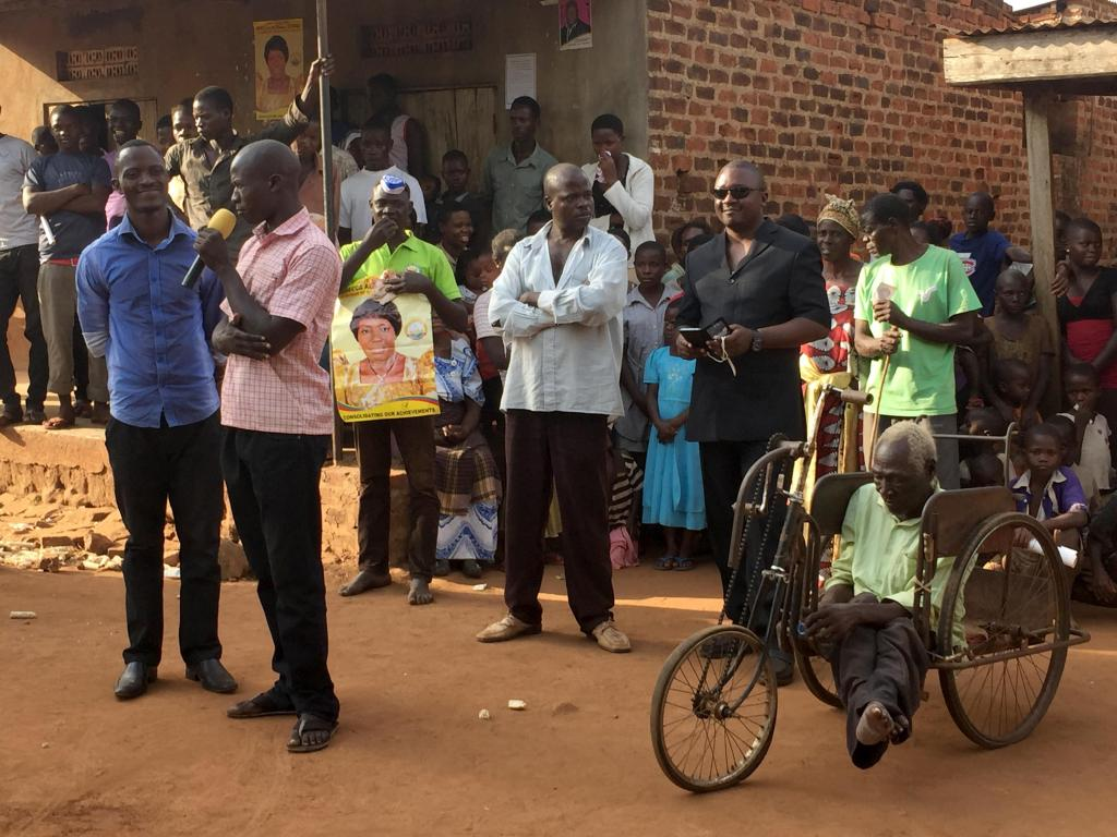 A disabled villager (right) waits for his turn to address Rebecca Kadaga during one of her campaign stops in Kamuli district. Photo by: Sonia Paul
