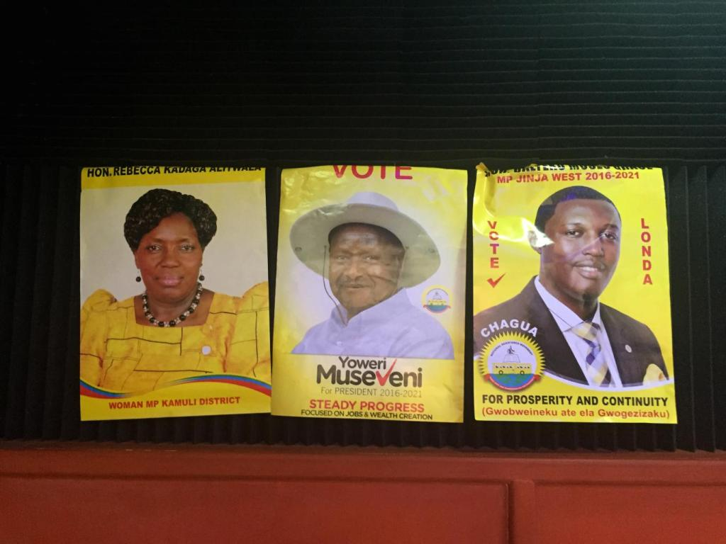 Campaign posters for politicians of the National Resistance Movement, Uganda's ruling political party, adorn the walls of a radio station in Jinja, a district in eastern Uganda, Feb. 6, 2016. Yoweri Museveni, center, is the president of Uganda and has just won his fifth term as president in the country's most recent elections. Photo: Sonia Paul