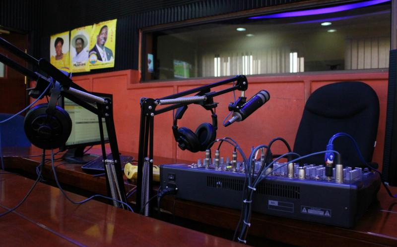 Inside the recording studio of one of numerous radio station in Uganda. Here, yellow posters featuring candidates of the ruling NRM party are affixed to the walls. (Sonia Paul/Foreign Affairs)